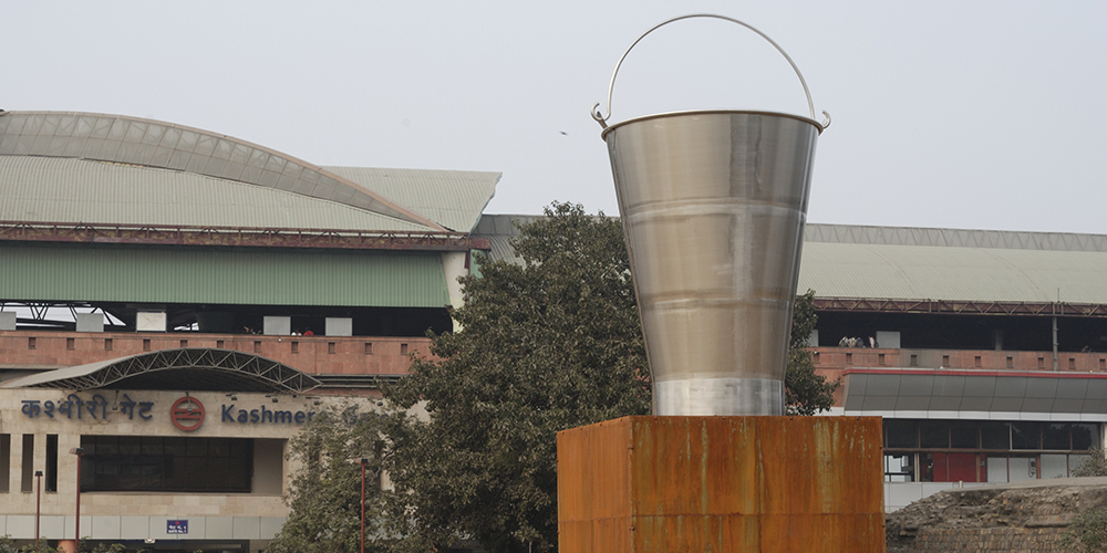 Subodh Gupta, The Steel Bucket, 2008. 48 Degrees Celsius. Public. Art. Ecology, Delhi. Image courtesy of Sanjit Das and Khoj International Artists' Association.